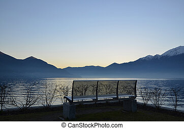 Blue hour - Sunset over an alpine lake with mountains and...