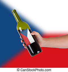 Hand holding a bottle of red wine, label of Chile, isolated...