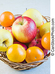 fruit large red ripe apples and tangerines in a ped