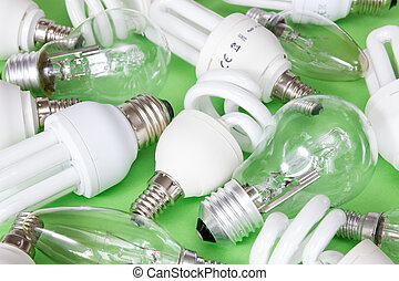 Collection of different kind of lightbulbs on green...