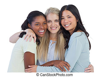 Happy friends embracing on white background