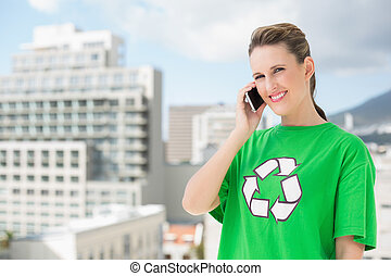 Smiling environmental activist talking on the phone