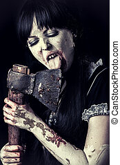 female zombie licking bloody axe - Dead female zombie...