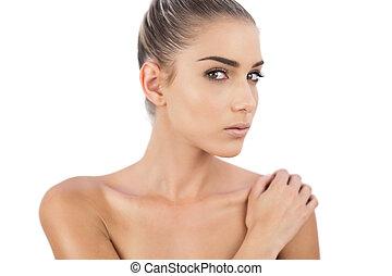 Close up of a thinking woman looking at camera