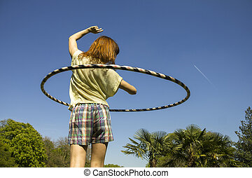 Woman with hoop in park
