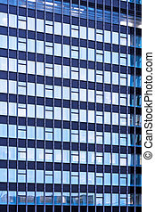 Blue glass facade texture of business skyscraper