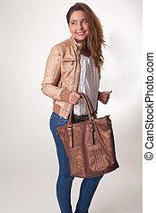 Stylish young woman with a handbag