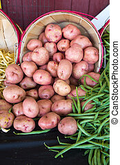 Potatoes and beans on a market