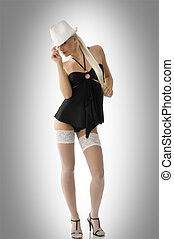 pinup and fedora - cute sexy blond girl in black dress...