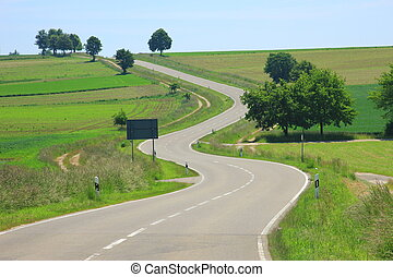 Curvaceous country road on the Swabian Alb,...