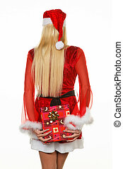 Female Santa Claus brings gifts - Young woman dressed as...