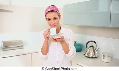 Beautiful brunette drinking coffee