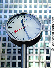 Bussines clock in front of office building