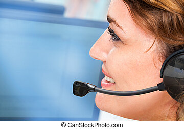 Woman talking on headset - Extreme close up portrait of...