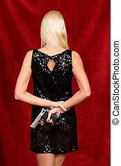 Woman in evening dress with a hidden weapon - Little Lady in...