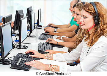 Young business people working on computers. - Group of young...