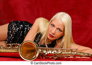 Young woman with her Saxophones - Young handsome musician...