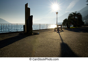 Lake front and sunshine - Lake front with bench and street...