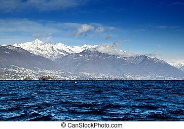 Lake with snow-capped mountains - Alpine lake with islands...