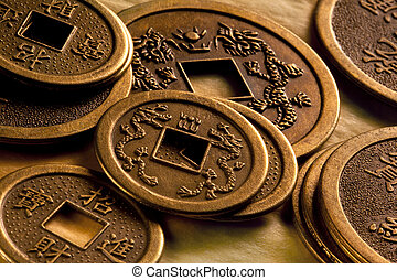 Old Chinese Coins - Antique Chinese coins on a table in a...