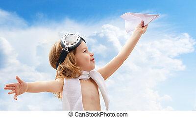 airplane pilot - A child plays an airplane pilot