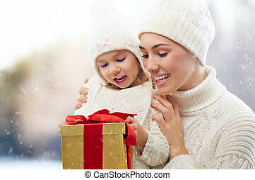 christmas gift - happy family with christmas gift