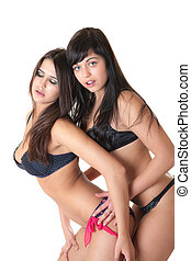 prelude - Two sensual girls in underwear, isolated on white
