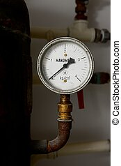 Manometer on an old rusty gas tank