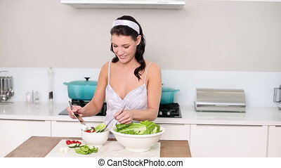 Beautiful brunette serving up a salad - Beautiful brunette...