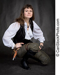 Girl - pirate with pistol sit on black background