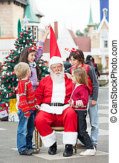 Children Playing With Santa Clauss Hat - Children playing...