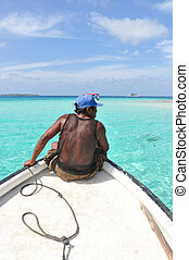Native on a boat daytrip. In the caribbean, San Blas islands, Panama. Central America. Perfect turquoise water.