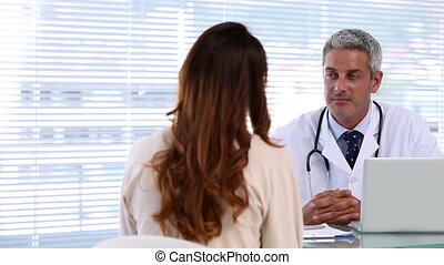 Doctor discussing with a patient