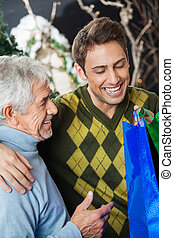 Happy Father And Son In Christmas Store - Happy father and...
