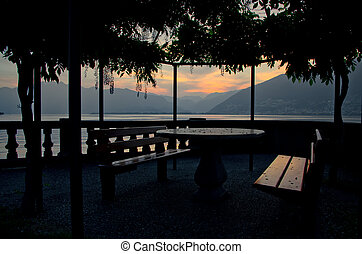Patio in sunset - Empty patio close to an alpine lake in...