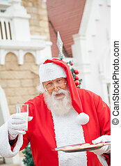 Santa Claus With Cookies And Milk - Portrait of Santa Claus...