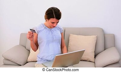 Pregnant woman using her laptop