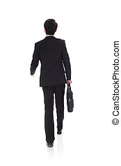 back view of a business man walking - back view of a...