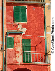 Red facade with green shutters.