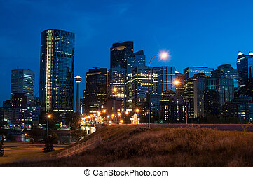 Calgary skyline at night with Bow River and Centre Street...