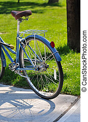 blue bicycle - womens bicycle parked on the street in sunny...