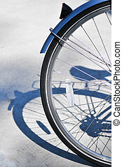 rear wheel of a blue bicycle - womens bicycle parked on the...