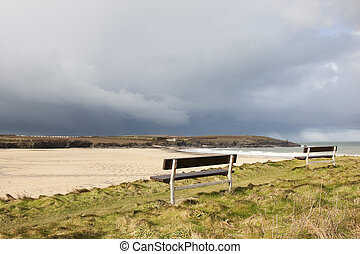 approaching storm clouds over a deserted beach