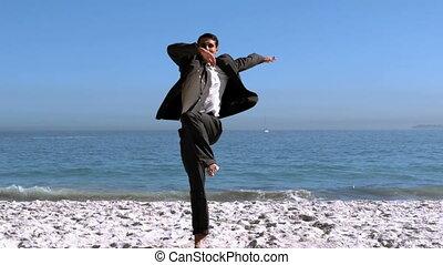 Handsome businessman jumping