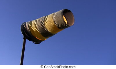 Windsock on blue background. - Yellow and brown color...
