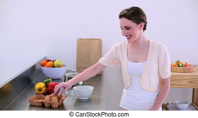 Pretty model standing in kitchen