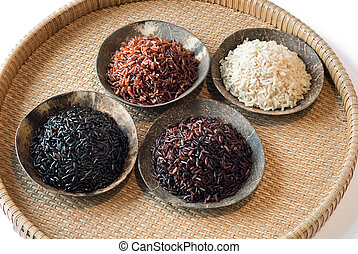4 bowls of raw rice; brown, red, black, and black sweet rice...