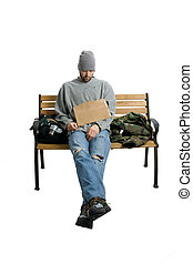 Homeless Bum on a Bench - A homeless man sits on a bench All...