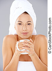 Beautiful woman enjoying coffee at a spa - Beautiful natural...