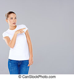 Woman pointing in disbelief - Casual attractive young woman...